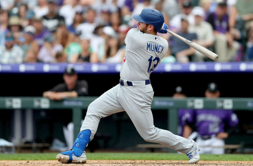 DENVER, COLORADO - JUNE 30: Max Muncy #13 of the Los Angeles Dodgers hits a RBI single in the sixth inning against the Colorado Rockies at Coors Field on June 30, 2019 in Denver, Colorado. (Photo by Matthew Stockman/Getty Images)