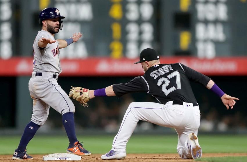 DENVER, COLORADO - JULY 02: Jose Altuve #27of the Houston Astros steals second base in the ninth inning against Trevor Story #27 of the Colorado Rockies at Coors Field on July 02, 2019 in Denver, Colorado. (Photo by Matthew Stockman/Getty Images)