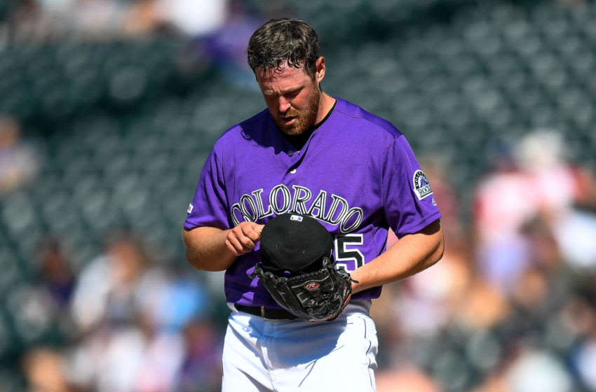 DENVER, CO - AUGUST 14: Scott Oberg #45 of the Colorado Rockies pause on the mound after allowing a go-ahead run in the ninth inning of a game against the Arizona Diamondbacks at Coors Field on August 14, 2019 in Denver, Colorado. (Photo by Dustin Bradford/Getty Images)