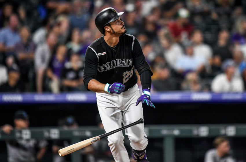 DENVER, CO - AUGUST 16: Nolan Arenado #28 of the Colorado Rockies hits an eighth inning solo homer against the Miami Marlins at Coors Field on August 16, 2019 in Denver, Colorado. (Photo by Dustin Bradford/Getty Images)