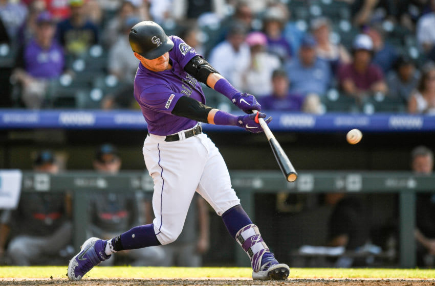 DENVER, CO - AUGUST 18: Trevor Story #27 of the Colorado Rockies hits a ninth inning sacrifice fly to score a run and tie the game against the Miami Marlins at Coors Field on August 18, 2019 in Denver, Colorado. (Photo by Dustin Bradford/Getty Images)