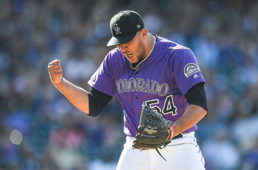 DENVER, CO - AUGUST 18: Carlos Estevez #54 of the Colorado Rockies reacts after striking out Lewis Brinson #9 of the Miami Marlins to end the top of the tenth inning of a game at Coors Field on August 18, 2019 in Denver, Colorado. (Photo by Dustin Bradford/Getty Images)