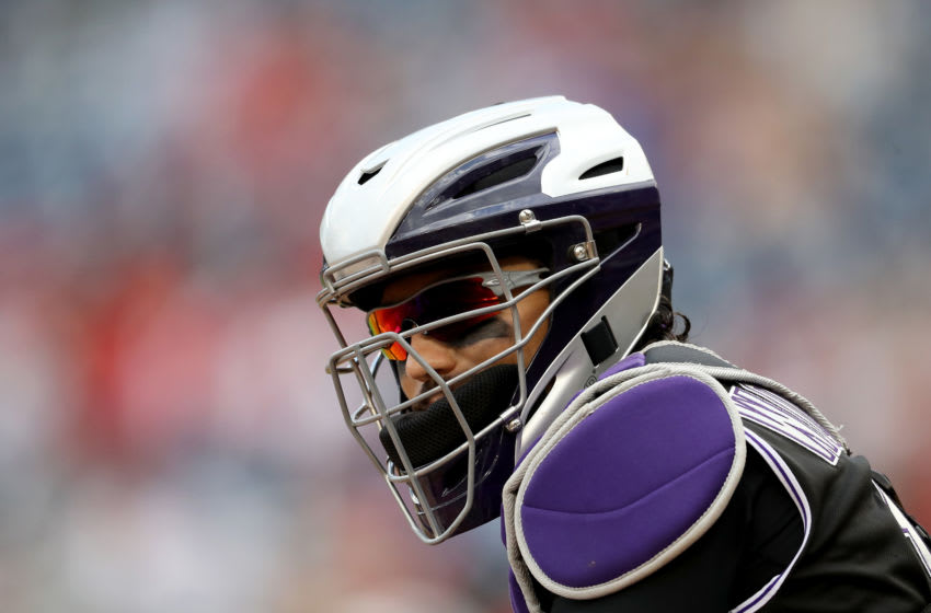 WASHINGTON, DC - JULY 25: Catcher Tony Wolters #14 of the Colorado Rockies looks on against the Washington Nationals at Nationals Park on July 25, 2019 in Washington, DC. (Photo by Rob Carr/Getty Images)