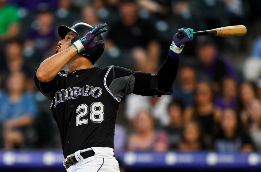 DENVER, CO - AUGUST 31: Nolan Arenado #28 of the Colorado Rockies hits a third inning run-scoring sacrifice fly against the Pittsburgh Pirates during a game at Coors Field on August 31, 2019 in Denver, Colorado. (Photo by Dustin Bradford/Getty Images)