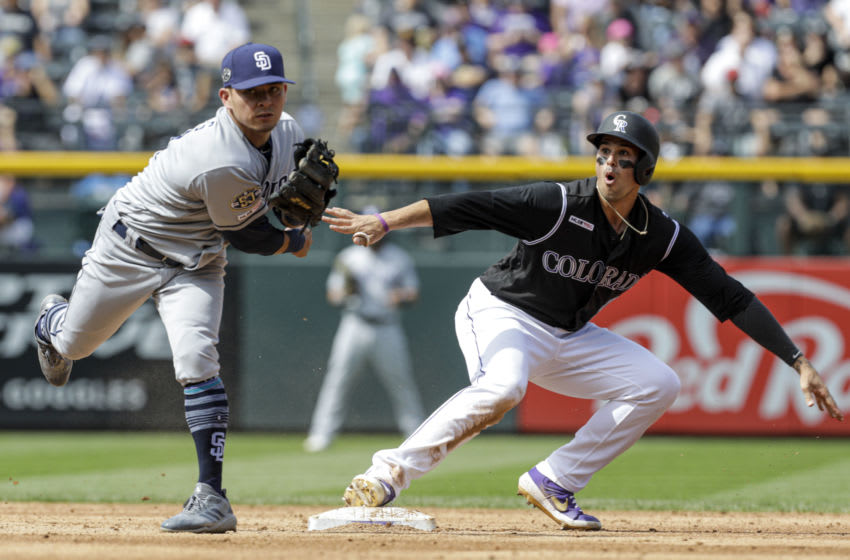 DENVER, CO - SEPTEMBER 15: Josh Fuentes #8 of the Colorado Rockies reaches second base safely as Luis Urias #9 of the San Diego Padres throws to first base in the second inning at Coors Field on September 15, 2019 in Denver, Colorado. (Photo by Joe Mahoney/Getty Images)