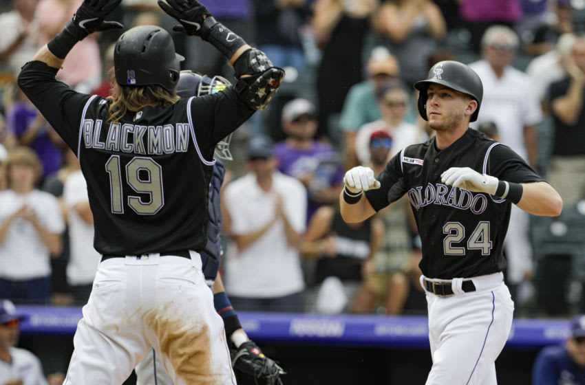 DENVER, CO - SEPTEMBER 15: Charlie Blackmon #19 of the Colorado Rockies waits to high five Ryan McMahon #24 of the Colorado Rockies after McMahon's two-run home run in the third inning against the San Diego Padres at Coors Field on September 15, 2019 in Denver, Colorado. (Photo by Joe Mahoney/Getty Images)