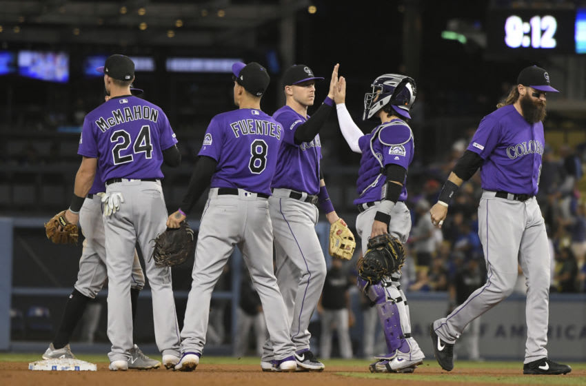 LOS ANGELES, CA - SEPTEMBER 21: The Colorado Rockies congratulate eachother after defeating the Los Angeles Dodgers 4-2 at Dodger Stadium on September 21, 2019 in Los Angeles, California. (Photo by John McCoy/Getty Images)