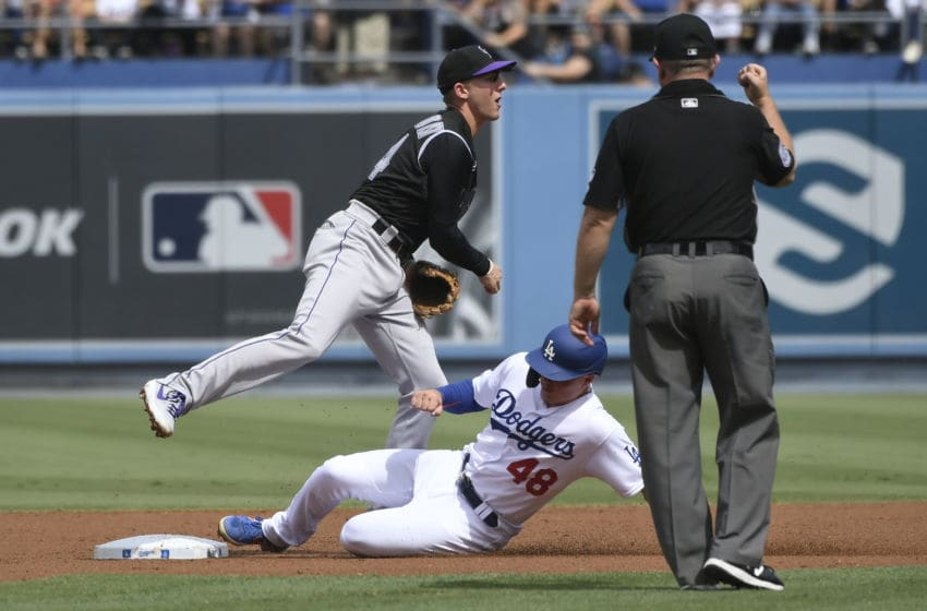 LOS ANGELES, CA - SEPTEMBER 22: Ryan McMahon #24 of the Colorado Rockies catches Gavin Lux #48 of the Los Angeles Dodgers in a double play at second base in the first inning at Dodger Stadium on September 22, 2019 in Los Angeles, California. (Photo by John McCoy/Getty Images)