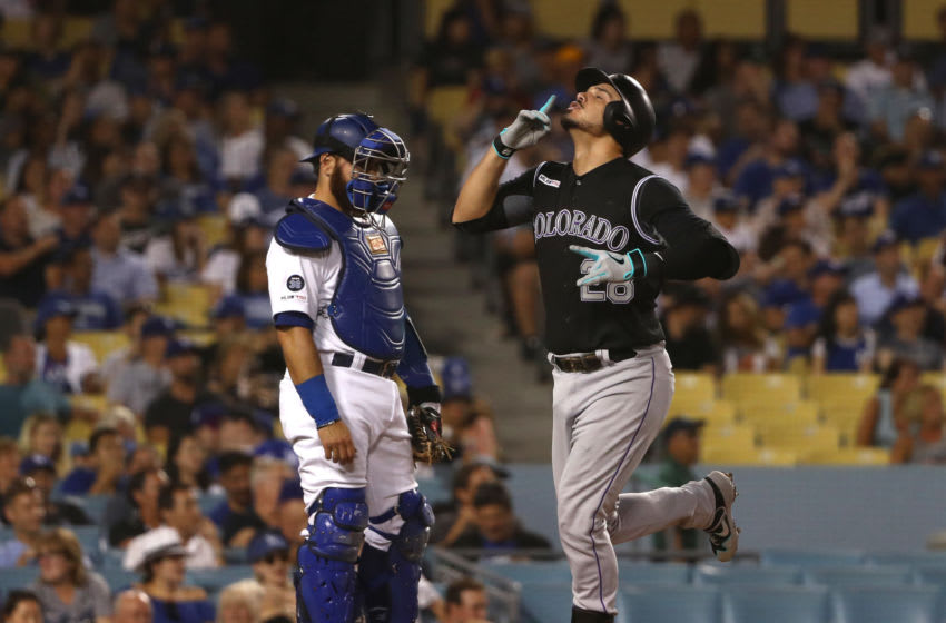 LOS ANGELES, CALIFORNIA - SEPTEMBER 03: Nolan Arenado #28 of the Colorado Rockies points toward the sky as he crosses home plate after hitting a solo home run as catcher Russell Martin #55 of the Los Angeles Dodgers looks on during the fourth inning of the MLB game at Dodger Stadium on September 03, 2019 in Los Angeles, California. (Photo by Victor Decolongon/Getty Images)