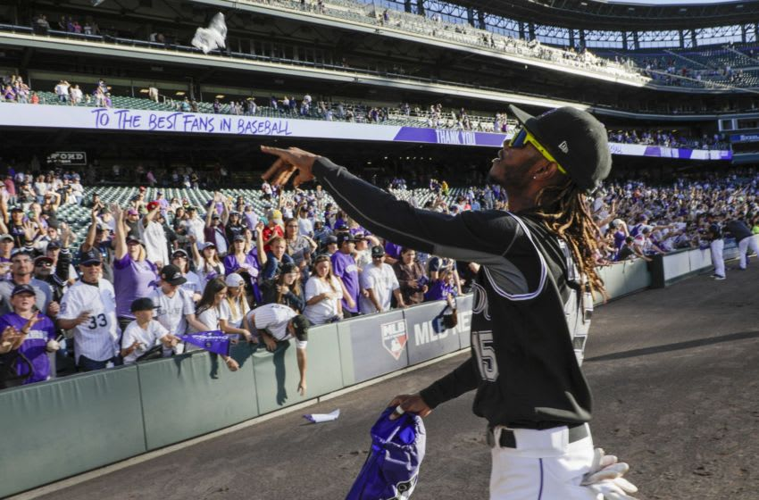 DENVER, CO - SEPTEMBER 29: Raimel Tapia #15 of the Colorado Rockies throws souvenirs to fans after the Rockies last game of the season at Coors Field on September 29, 2019 in Denver, Colorado. Colorado beat the Milwaukee Brewers 4-3 in 13 innings. (Photo by Joe Mahoney/Getty Images)