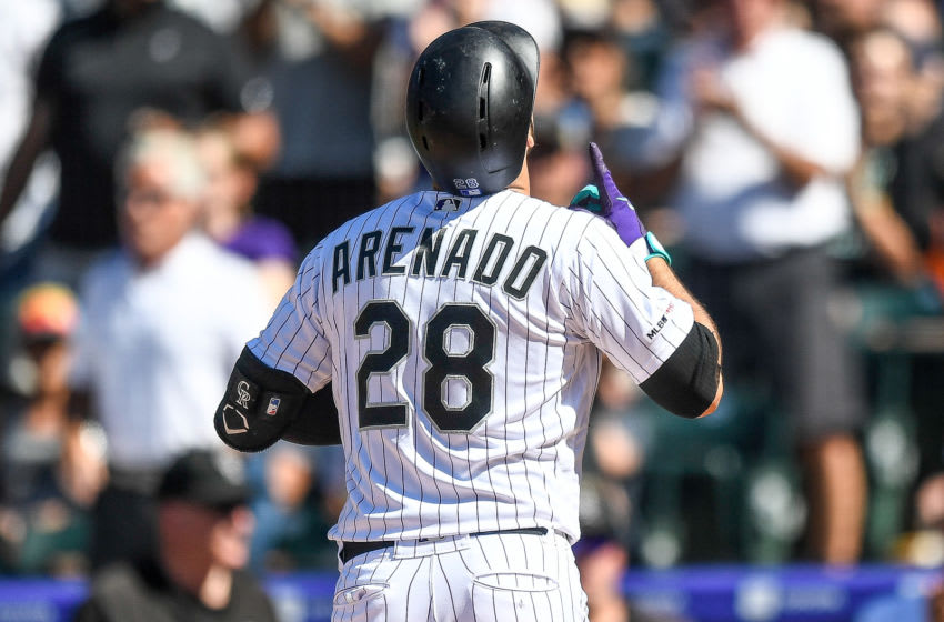 DENVER, CO - SEPTEMBER 1: Nolan Arenado #28 of the Colorado Rockies celebrates after hitting a sixth inning solo home run against the Pittsburgh Pirates at Coors Field on September 1, 2019 in Denver, Colorado. (Photo by Dustin Bradford/Getty Images)