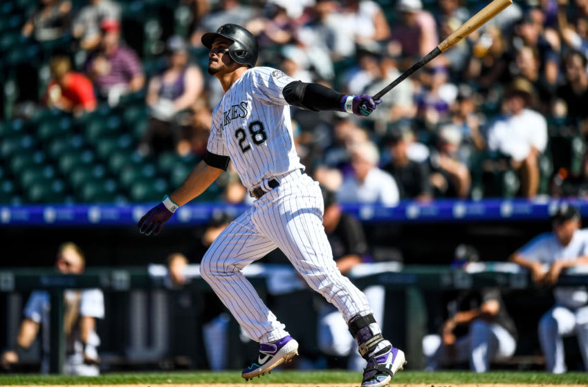 DENVER, CO - SEPTEMBER 1: Nolan Arenado #28 of the Colorado Rockies follows the flight of a sixth inning solo home run against the Pittsburgh Pirates at Coors Field on September 1, 2019 in Denver, Colorado. (Photo by Dustin Bradford/Getty Images)
