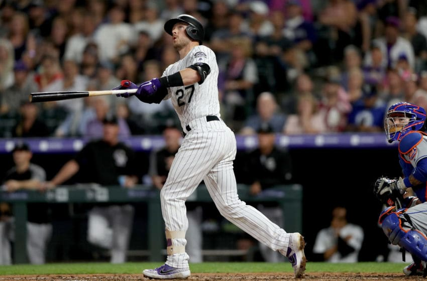 DENVER, COLORADO - SEPTEMBER 16: Trevor Story #27 of the Colorado Rockies hits a three RBI home run in the fourth inning against the New York Mets at Coors Field on September 16, 2019 in Denver, Colorado. (Photo by Matthew Stockman/Getty Images)