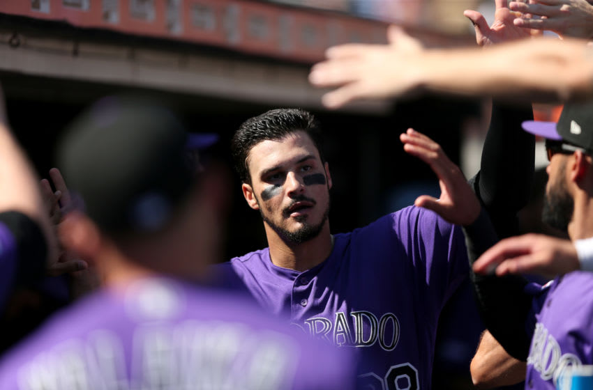 SAN FRANCISCO, CALIFORNIA - SEPTEMBER 26: Nolan Arenado #28 of the Colorado Rockies is congratulated by players after he scored in the fourth inning against the San Francisco Giants at Oracle Park on September 26, 2019 in San Francisco, California. (Photo by Ezra Shaw/Getty Images)