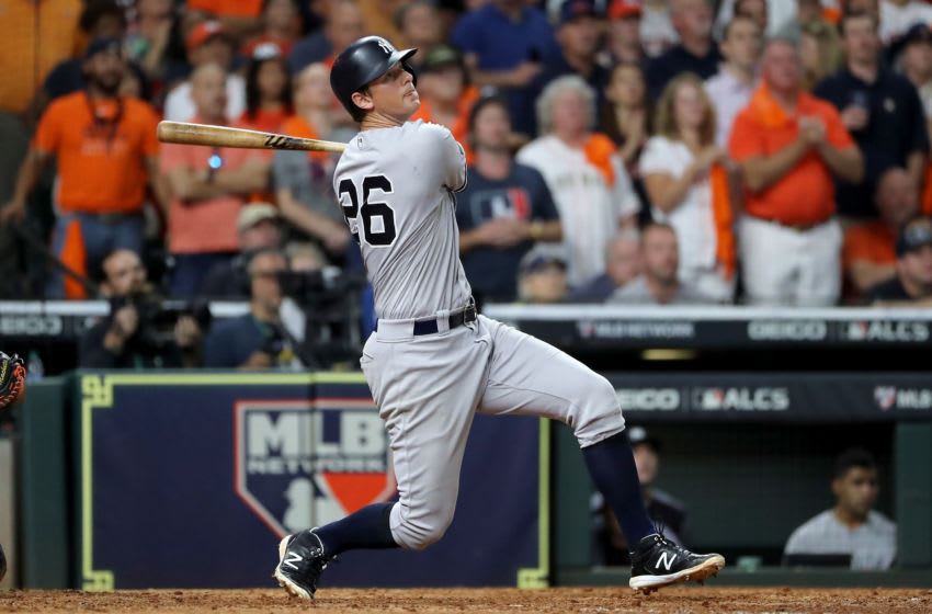 HOUSTON, TEXAS - OCTOBER 19: DJ LeMahieu #26 of the New York Yankees hits a game-tying two-run home run against the Houston Astros during the ninth inning in game six of the American League Championship Series at Minute Maid Park on October 19, 2019 in Houston, Texas. (Photo by Elsa/Getty Images)