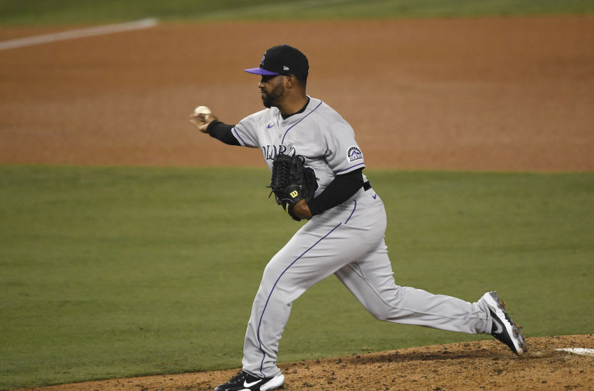 LOS ANGELES, CA - SEPTEMBER 04: Relief pitcher Mychal Givens #60 of the Colorado Rockies throws against the Los Angeles Dodgers during the sixth inning at Dodger Stadium on September 4, 2020 in Los Angeles, California. (Photo by Kevork Djansezian/Getty Images)