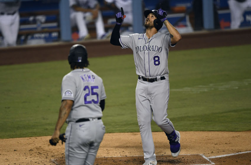 LOS ANGELES, CA - SEPTEMBER 06: Josh Fuentes #8 of the Colorado Rockies celebrates at home plate after hitting a two run home run against starting pitcher Julio Urias #7 of the Los Angeles Dodgers during the second inning at Dodger Stadium on September 6, 2020 in Los Angeles, California. (Photo by Kevork Djansezian/Getty Images)