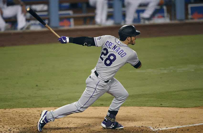 LOS ANGELES, CA - SEPTEMBER 06: Nolan Arenado #28 of the Colorado Rockies hits a base hit to score Raimel Tapia #15 of the Colorado Rockies from third base during the fifth inning against the Los Angeles Dodgers at Dodger Stadium on September 6, 2020 in Los Angeles, California. (Photo by Kevork Djansezian/Getty Images)