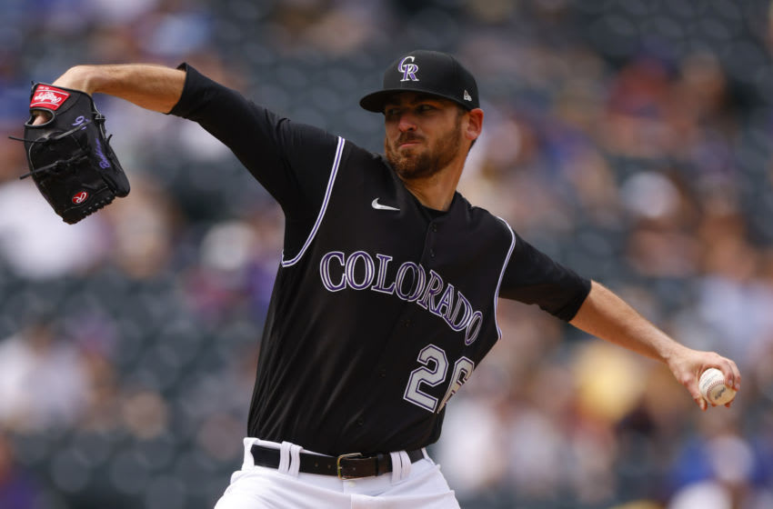 DENVER, CO - APRIL 4: Starting pitcher Austin Gomber #26 of the Colorado Rockies delivers to home plate during the first inning against the Los Angeles Dodgers at Coors Field on April 4, 2021 in Denver, Colorado. (Photo by Justin Edmonds/Getty Images)