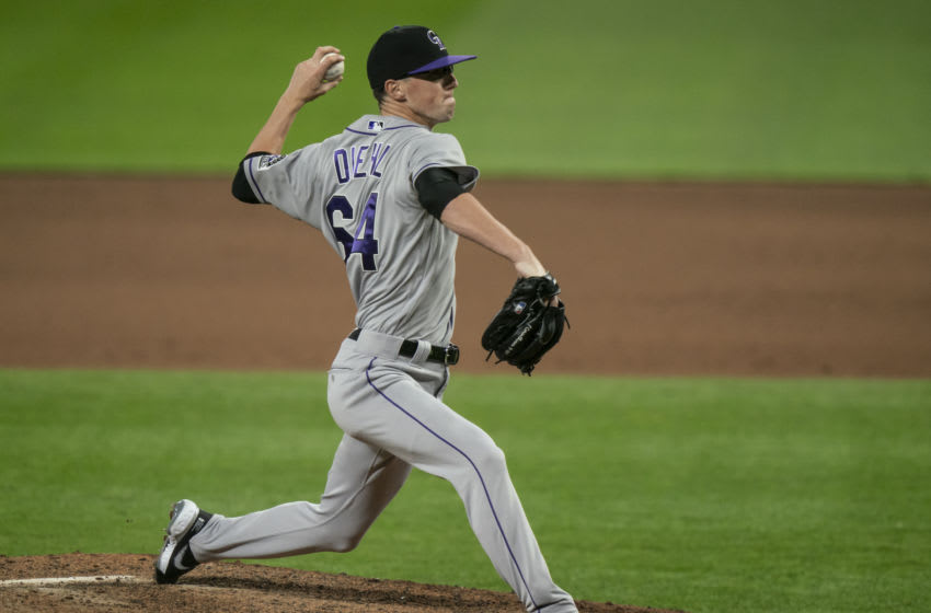 SEATTLE, WA - AUGUST 08: Reliever Phillip Diehl #64 of the Colorado Rockies delivers a pitch during a game against the Seattle Mariners at T-Mobile Park on August, 8, 2020 in Seattle, Washington. The Rockies won 5-0. (Photo by Stephen Brashear/Getty Images)