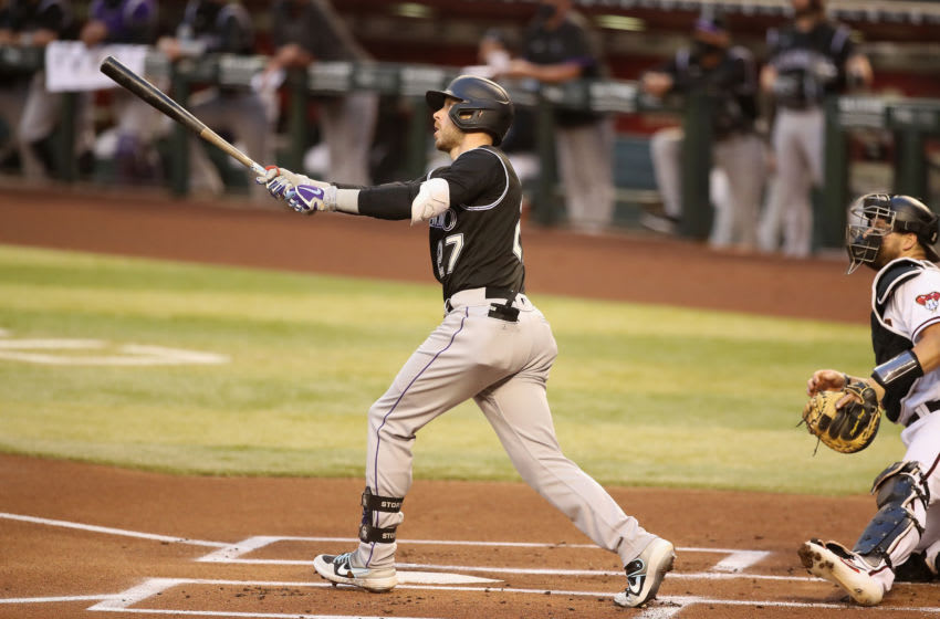 PHOENIX, ARIZONA - AUGUST 24: Trevor Story #27 of the Colorado Rockies hits a solo home run against the Arizona Diamondbacks during the first inning of the MLB game at Chase Field on August 24, 2020 in Phoenix, Arizona. (Photo by Christian Petersen/Getty Images)