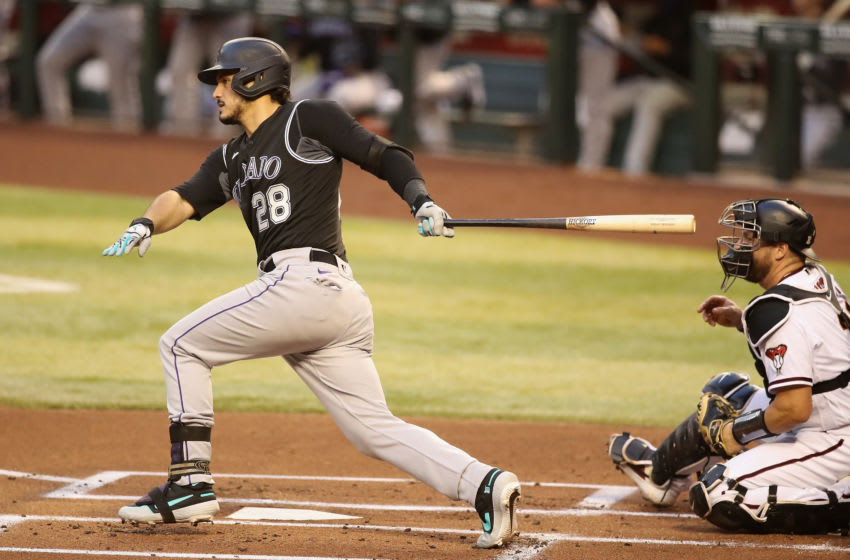 PHOENIX, ARIZONA - AUGUST 24: Nolan Arenado #28 of the Colorado Rockies hits a single against the Arizona Diamondbacks during the first inning of the MLB game at Chase Field on August 24, 2020 in Phoenix, Arizona. (Photo by Christian Petersen/Getty Images)