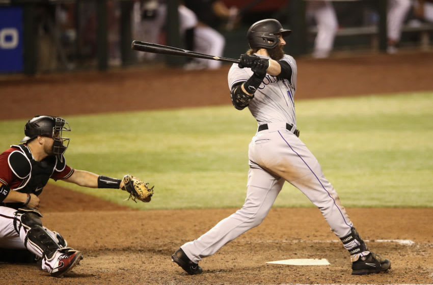 PHOENIX, ARIZONA - AUGUST 26: Charlie Blackmon #19 of the Colorado Rockies hits a grand-slam home run against the Arizona Diamondbacks during the eighth inning of the MLB game at Chase Field on August 26, 2020 in Phoenix, Arizona. (Photo by Christian Petersen/Getty Images)