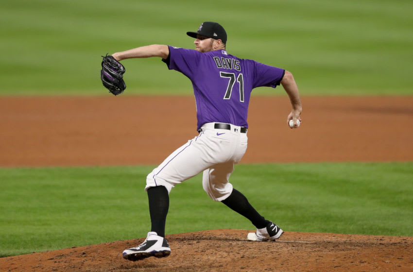 DENVER, COLORADO - SEPTEMBER 18: Pitcher Wade Davis #71 of the Colorado Rockies throws in the seventh inning against the Los Angeles Dodgers at Coors Field on September 18, 2020 in Denver, Colorado. (Photo by Matthew Stockman/Getty Images)