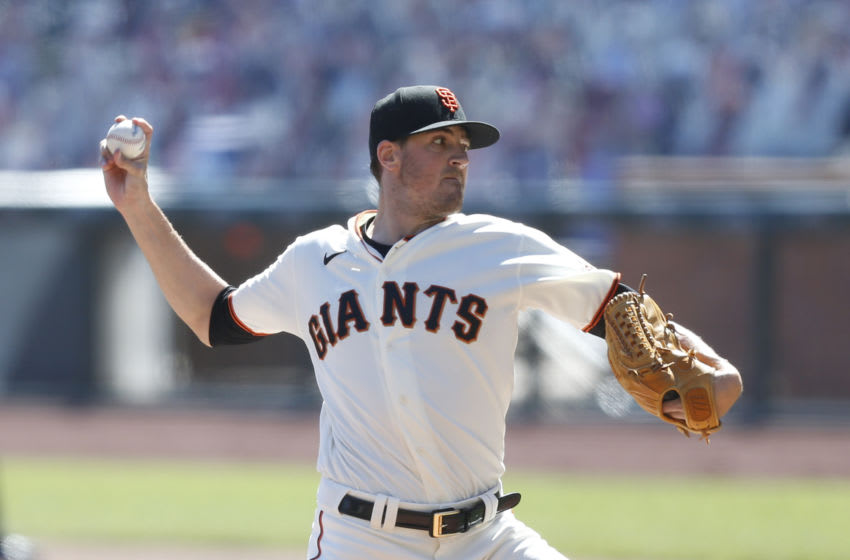 SAN FRANCISCO, CALIFORNIA - SEPTEMBER 24: Kevin Gausman #34 of the San Francisco Giants pitches in the top of the first inning against the Colorado Rockies at Oracle Park on September 24, 2020 in San Francisco, California. (Photo by Lachlan Cunningham/Getty Images)