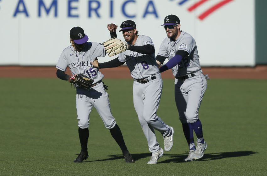 SAN FRANCISCO, CALIFORNIA - SEPTEMBER 24: Raimel Tapia #15, Josh Fuentes #8 and Sam Hilliard #22 of the Colorado Rockies celebrate after a win against the San Francisco Giants at Oracle Park on September 24, 2020 in San Francisco, California. (Photo by Lachlan Cunningham/Getty Images)