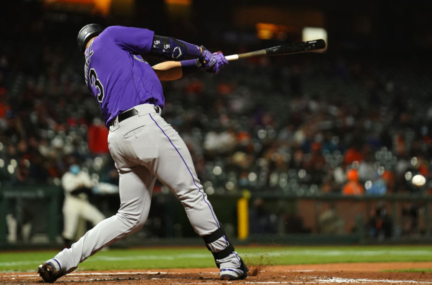 SAN FRANCISCO, CALIFORNIA - APRIL 27: Dom Nunez #3 of the Colorado Rockies drives in a run during the sixth inning of the game against the San Francisco Giants at Oracle Park on April 27, 2021 in San Francisco, California. (Photo by Daniel Shirey/Getty Images)