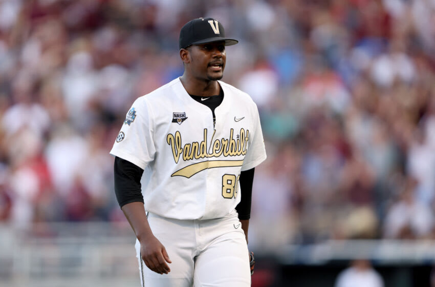 OMAHA, NEBRASKA - JUNE 30: Starting pitcher Kumar Rocker #80 of the Vanderbilt reacts to being pulled from the game against Mississippi St. by Head Coach Tim Corbin of the Vanderbilt in the top of the fifth inning during game three of the College World Series Championship at TD Ameritrade Park Omaha on June 30, 2021 in Omaha, Nebraska. (Photo by Sean M. Haffey/Getty Images)