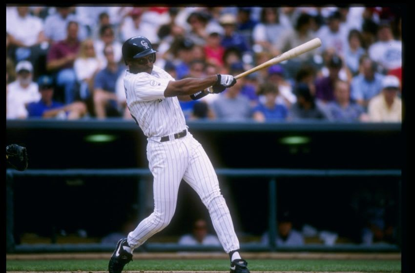 12 Jun 1996: Center fielder Ellis Burks of the Colorado Rockies swings at the ball during a game against the Houston Astros at Coors Field in Denver, Colorado. The Rockies won the game 8-0. Mandatory Credit: Stephen Dunn /Allsport