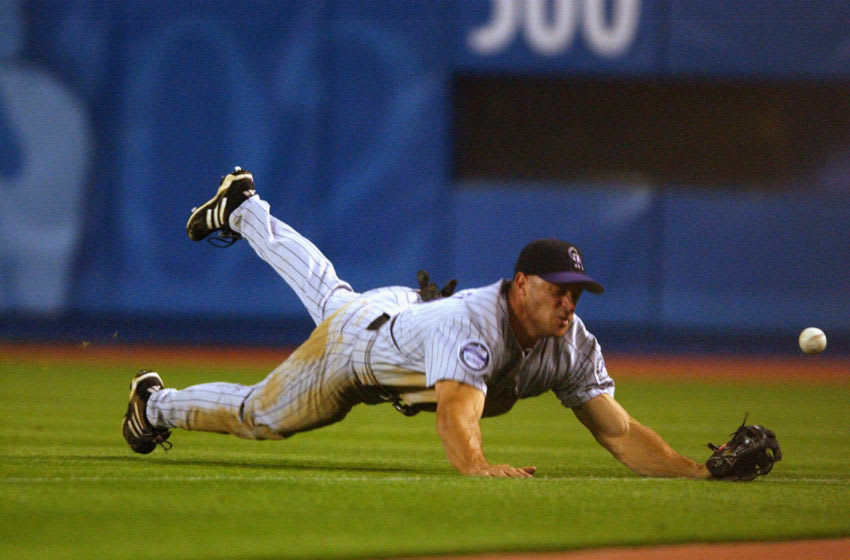 LOS ANGELES - SEPTEMBER 24: Rightfielder Gabe Kapler #19 of the Colorado Rockies dives for a ball off the bat of centerfielder Marquis Grissom #9 of the Los Angeles Doodgers during the eighth inning on September 24, 2002 at Dodger Stadium in Los Angeles, California. The Rockies shut out the Dodgers 1-0. (Photo by Harry How/Getty Images)