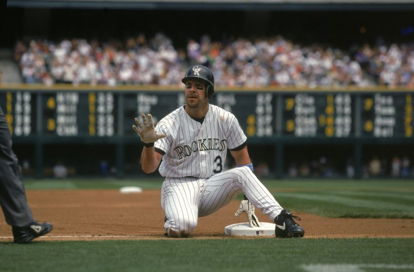 18 Jun 2000: Mike Lansing #3 of the Colorado Rockies touches the base during a game against the Arizona Diamondbacks at Coors Field in Denver, Colorado. The Rockies defeated the Diamondbacks 19-2.Mandatory Credit: Rodolfo Ganzales /Allsport