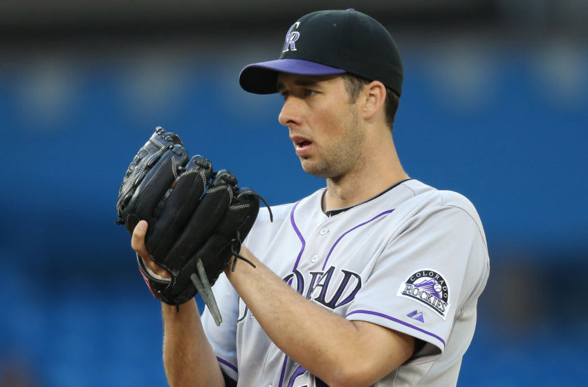 TORONTO, CANADA - JUNE 18: Jeff Francis #26 of the Colorado Rockies looks in before delivering a pitch during MLB game action against the Toronto Blue Jays on June 18, 2013 at Rogers Centre in Toronto, Ontario, Canada. (Photo by Tom Szczerbowski/Getty Images)