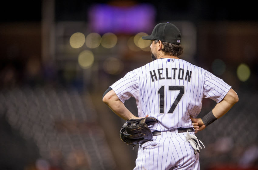 DENVER, CO - AUGUST 30: Todd Helton #17 of the Colorado Rockies stands at first base in the ninth inning of a game against the Cincinnati Reds at Coors Field on August 30, 2013 in Denver, Colorado. The Rockies beat the Reds 9-6. (Photo by Dustin Bradford/Getty Images)