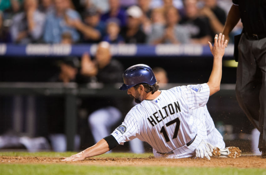 DENVER, CO - SEPTEMBER 18: Todd Helton #17 of the Colorado Rockies slides across home plate to score from second base in the sixth inning of a game against the St. Louis Cardinals at Coors Field on September 18, 2013 in Denver, Colorado. (Photo by Dustin Bradford/Getty Images)