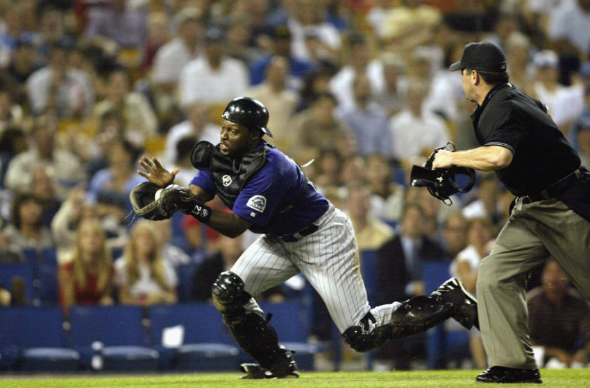 LOS ANGELES - JULY 23: Catcher Charles Johnson #23 of the Colorado Rockies catches a pop-up from a botched bunt attempt by Kazuhisa Ishii #17 of the Los Angeles Dodgers during their game on July 23, 2003 at Dodger Stadium in Los Angeles, California. (Photo by Jeff Gross/Getty Images)