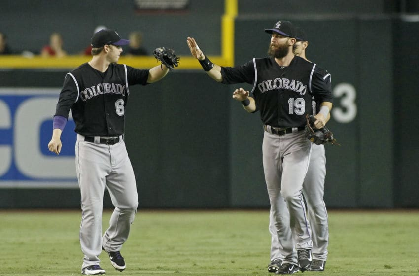 PHOENIX, AZ - AUGUST 30: Corey Dickerson #6 and Charlie Blackmon #19 of the Colorado Rockies celebrate a 2-0 victory against the Arizona Diamondbacks during a MLB game at Chase Field on August 30, 2014 in Phoenix, Arizona. Blackmon had a solo home run in the victory. (Photo by Ralph Freso/Getty Images)