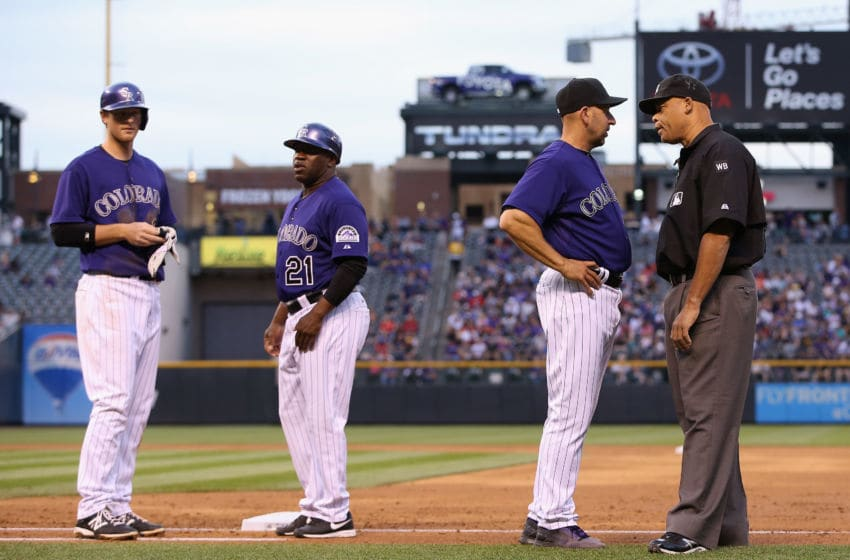 DENVER, CO - MAY 05: Manager Walt Weiss #22 of the Colorado Rockies challenges a call by umpire Kerwin Danley on a play at first base against the Texas Rangers as DJ LeMahieu #9 and Eric Young #21 of the Colorado Rockies looks on in the second inning during Interleague play at Coors Field on May 5, 2014 in Denver, Colorado. Danley called DJ LeMahieu #9 of the Colorado Rockies out and the call was overturned after video replay as the Rockies defeated the Rangers 8-2. (Photo by Doug Pensinger/Getty Images)