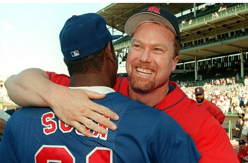 CHICAGO, IL - AUGUST 18: This 18 August 1998 file photo shows St. Louis Cardinals player Mark McGwire (R) hugging Chicago Cubs player Sammy Sosa before their game at Wrigley Field in Chicago, IL. Currently McGwire has 59 homeruns and Sosa 56, giving both players a chance to break the single season record of 61 set in 1961 by New York Yankees player Roger Maris. Despite the competition between them to be the first to break the record, they are close friends. (Photo credit should read FILE/AFP via Getty Images)
