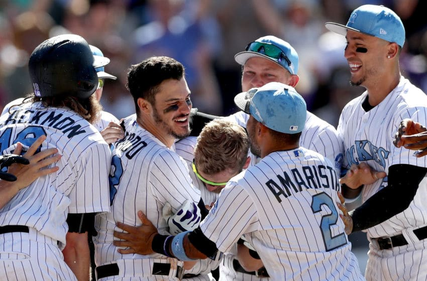 DENVER, CO - JUNE 18: Nolan Arenado #28 of the Colorado Rockies celebrates with his teammates after hitting a 3 RBI walk off home run in the ninth inning against the San Francisco Giants at Coors Field on June 18, 2017 in Denver, Colorado. (Photo by Matthew Stockman/Getty Images)