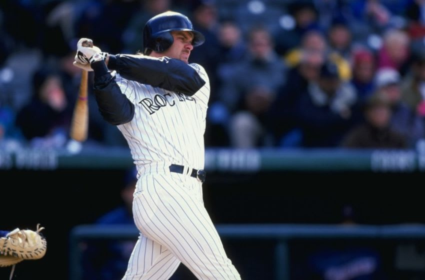 15 Apr 1999: Larry Walker #33 of the Colorado Rockies swings at the ball during the game against the San Diego Padres at Coors Field in Denver, Colorado. The Rockies defeated the Padres 6-4.