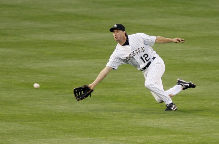 DENVER - MAY 10: Center fielder Steve Finley #12 of the Colorado Rockies dives to catch a fly ball by Ryan Klesko of the San Francisco Giants in the fourth inning on May 10, 2007 at Coors Field in Denver, Colorado. The Rockies won 5-3. (Photo by Brian Bahr/Getty Images)