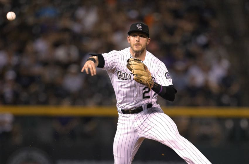 DENVER, CO - SEPTEMBER 02: Trevor Story #27 of the Colorado Rockies throws to first base after fielding a ground ball by A.J. Pollock #11 of the Arizona Diamondbacks in the eighth inning at Coors Field on September 2, 2017 in Denver, Colorado. Arizona won 6-2. (Photo by Joe Mahoney/Getty Images)