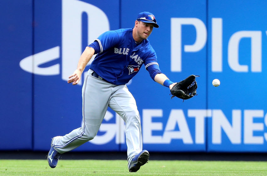 NEW YORK, NY - SEPTEMBER 29: Michael Saunders #21 of the Toronto Blue Jays grounds a ball in the first inning against the New York Yankees at Yankee Stadium on September 29, 2017 in the Bronx borough of New York City. (Photo by Abbie Parr/Getty Images)
