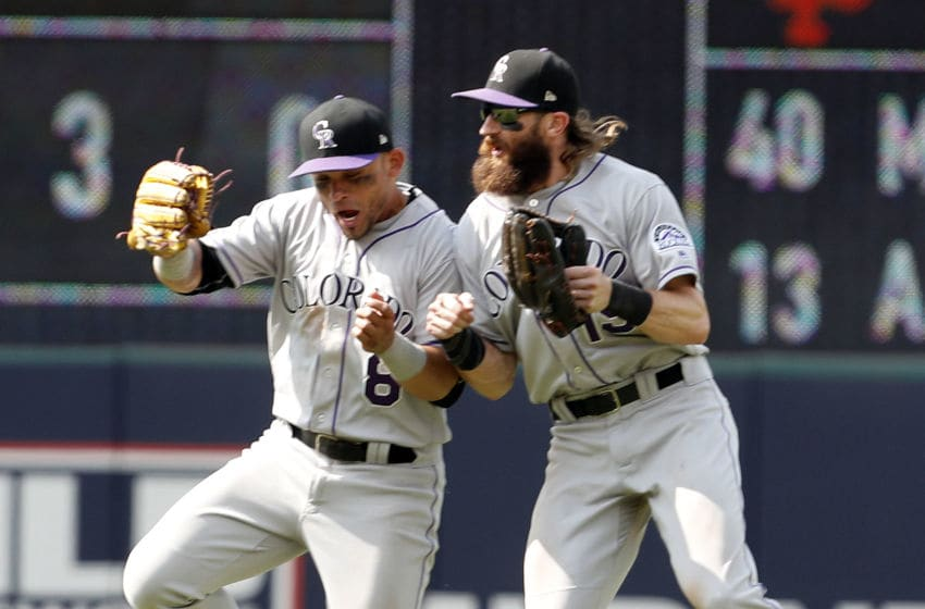 CLEVELAND, OH - AUGUST 09: Charlie Blackmon #19 and Gerardo Parra #8 of the Colorado Rockies celebrate after defeating the Cleveland Indians in 12 innings at Progressive Field on August 9, 2017 in Cleveland, Ohio. (Photo by David Maxwell/Getty Images)