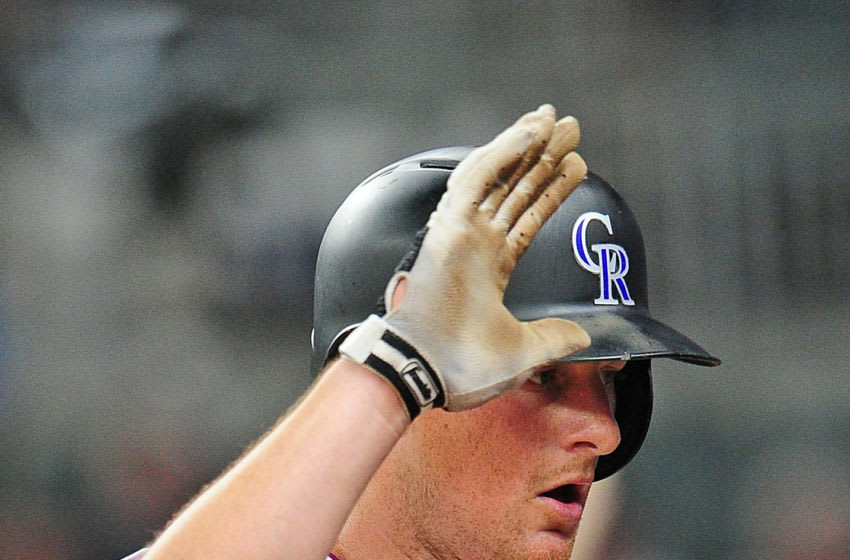 ATLANTA, GA - AUGUST 26: D. J. LeMahieu #9 of the Colorado Rockies celebrates with teammates after hitting a ninth inning solo home run against the Atlanta Braves at SunTrust Park on August 26, 2017 in Atlanta, Georgia. (Photo by Scott Cunningham/Getty Images)