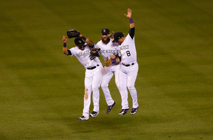 DENVER, CO - AUGUST 29: (L-R) Ian Desmond #20, Charlie Blackmon #19 and Gerardo Parra #8 of the Colorado Rockies celebrate the Rockies 7-3 win against the Detroit Tigers following an interleague game at Coors Field on August 29, 2017 in Denver, Colorado. (Photo by Justin Edmonds/Getty Images)